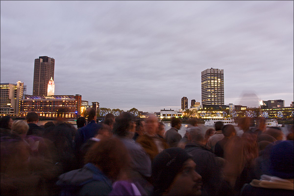 Crowds by the Thames waiting for Fireworks.