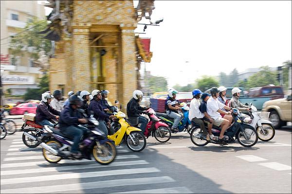 Motorbikes racing away as the lights change.