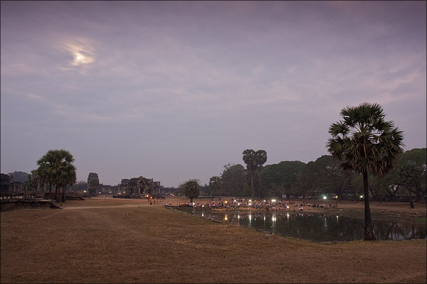 Photographers and their flashing cameras at Angkor Wat.