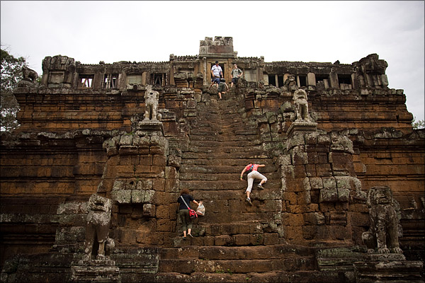 Climbing the steep stairs of a temple.