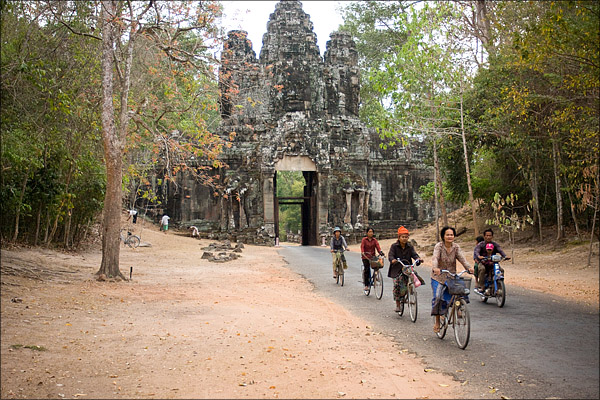 Passing traffic coming through the east gate of Angkor Thom.