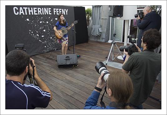 Catherine plays, the photographers shoot.