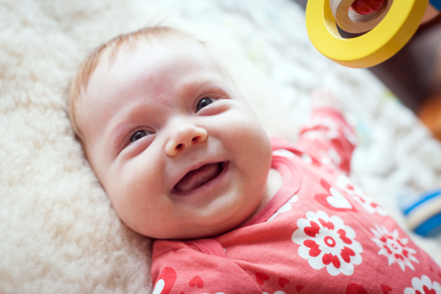 Alayna smiling at 2 months old