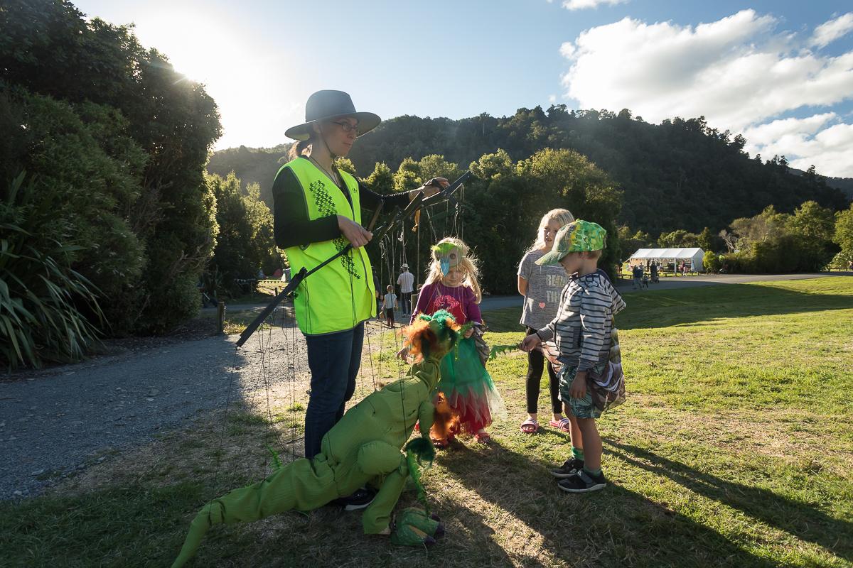 Puppet dinosaur feeding