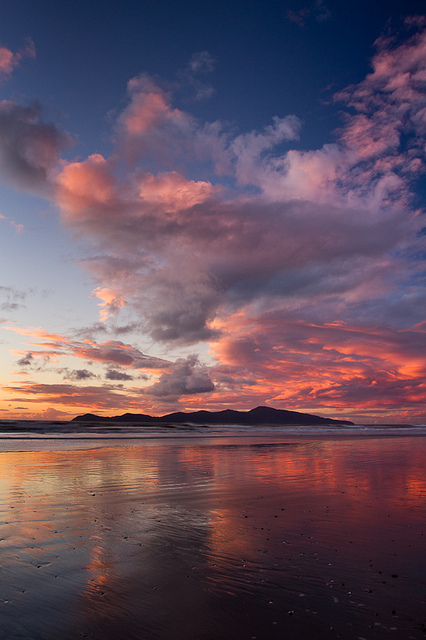 Sunset lights the clouds over Kapiti Island