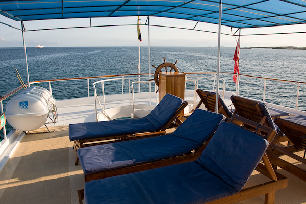 Exploring the boat: the sun loungers.