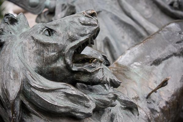 A lion on the war memorial in the Plaza Grande o de la Independencia