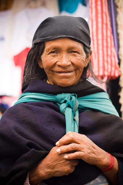 This woman was politely begging in the market, the price for a photo $1