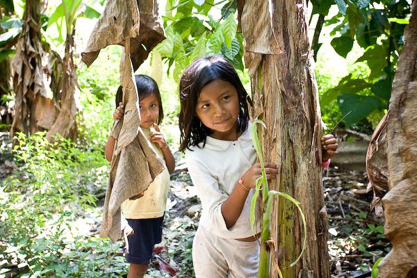 Two local children watch