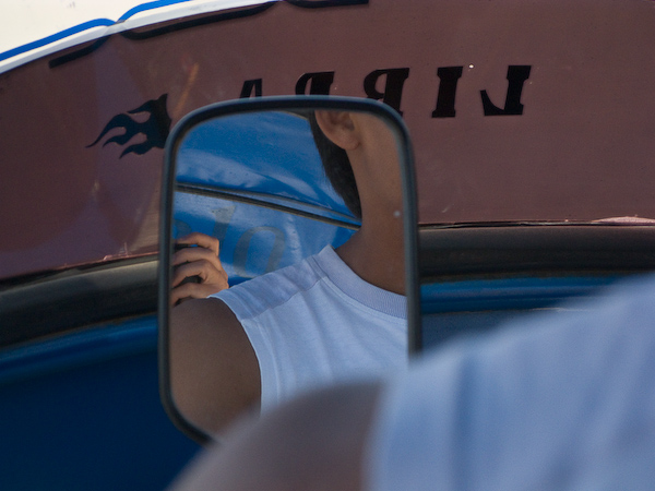 Spying on the driver while we journeyed back to Punta Sal