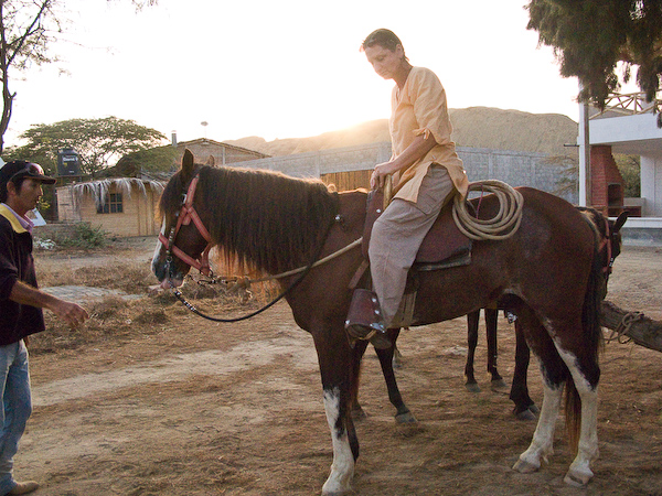 Angie getting started on the horse riding in the early morning sunrise