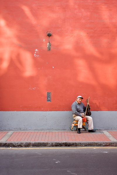 The blind man with his violin