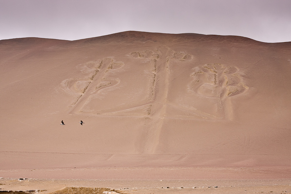The pre-Inca carving on the dune