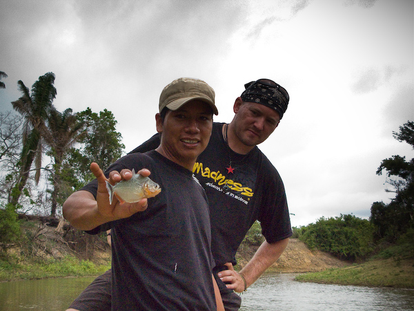 Our guide catches a piranha