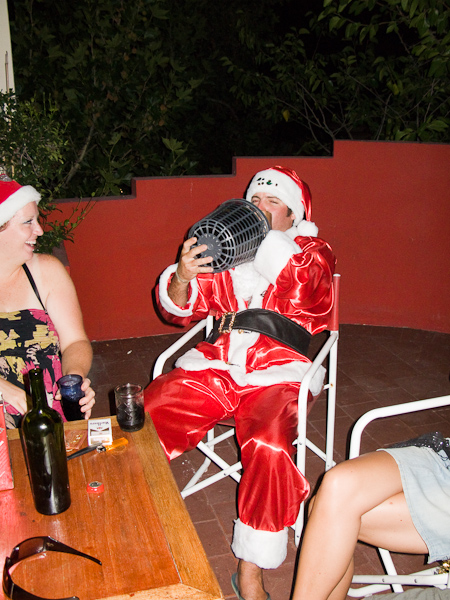 Santa celebrates with a little vino
