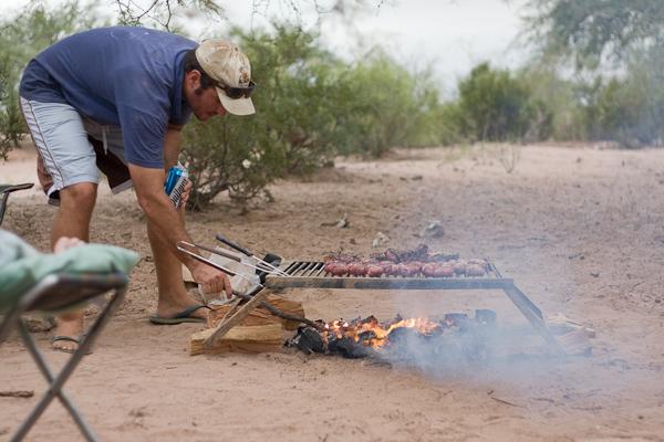 Rhys prepares the BBQ