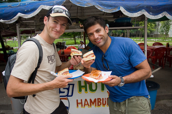 Mark and Juan Pablo share their quartered burger