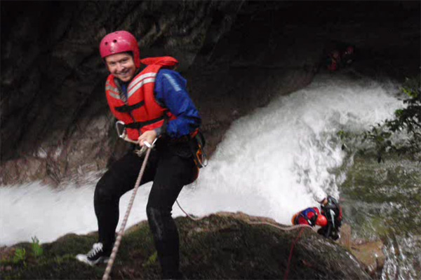Abseiling by the waterfall